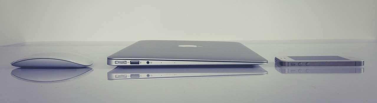 Bild på en dator och en telefon